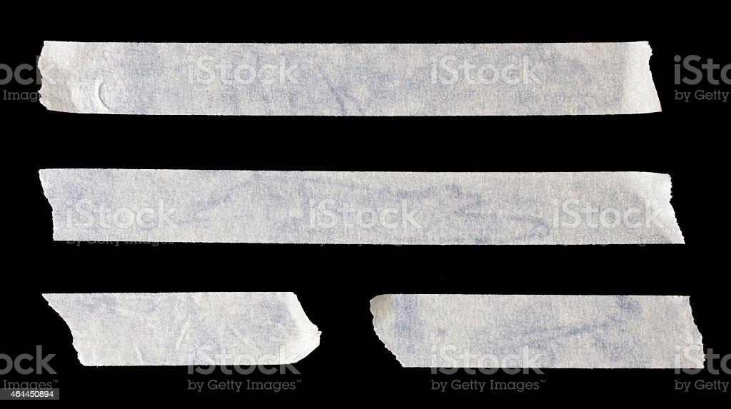 Four white strips of paper tape stock photo