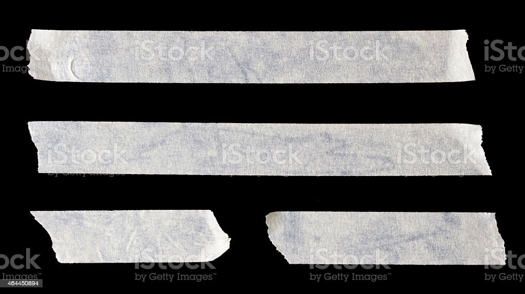 Four white strips of paper tape stock photo