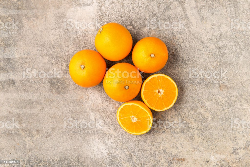 Four Whole and a Sliced Ripe Orange stock photo