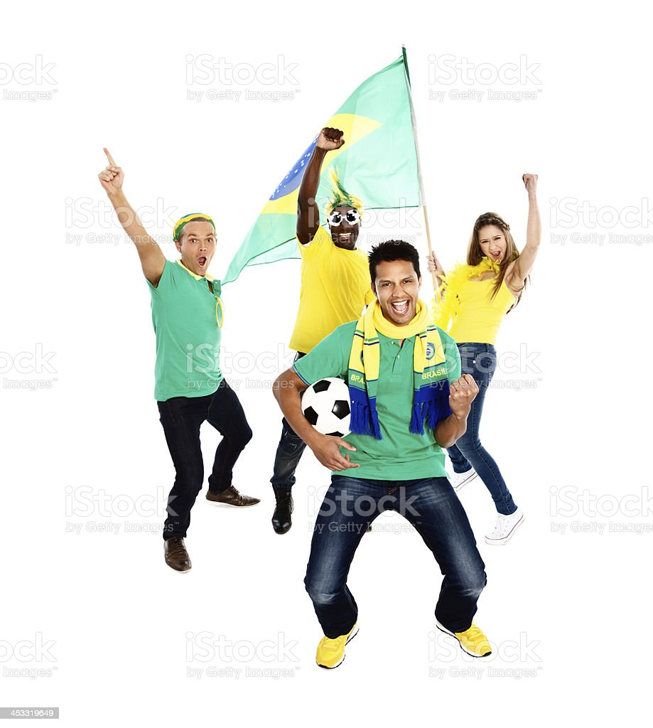 Four wildly excited Brazilian football fans congratulate their team royalty-free stock photo
