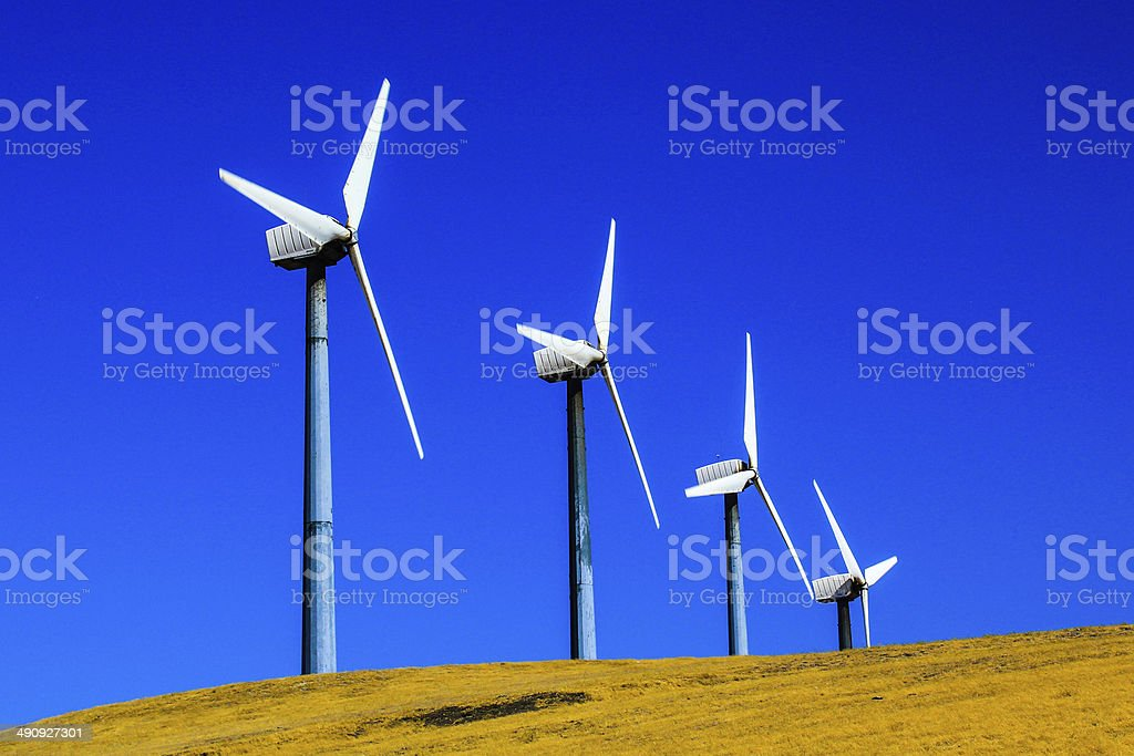 Four Windmills on a Hill stock photo