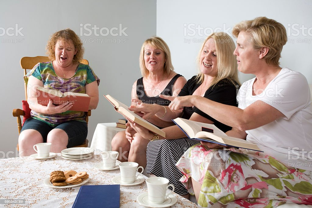 Four Women Discussing Book stock photo