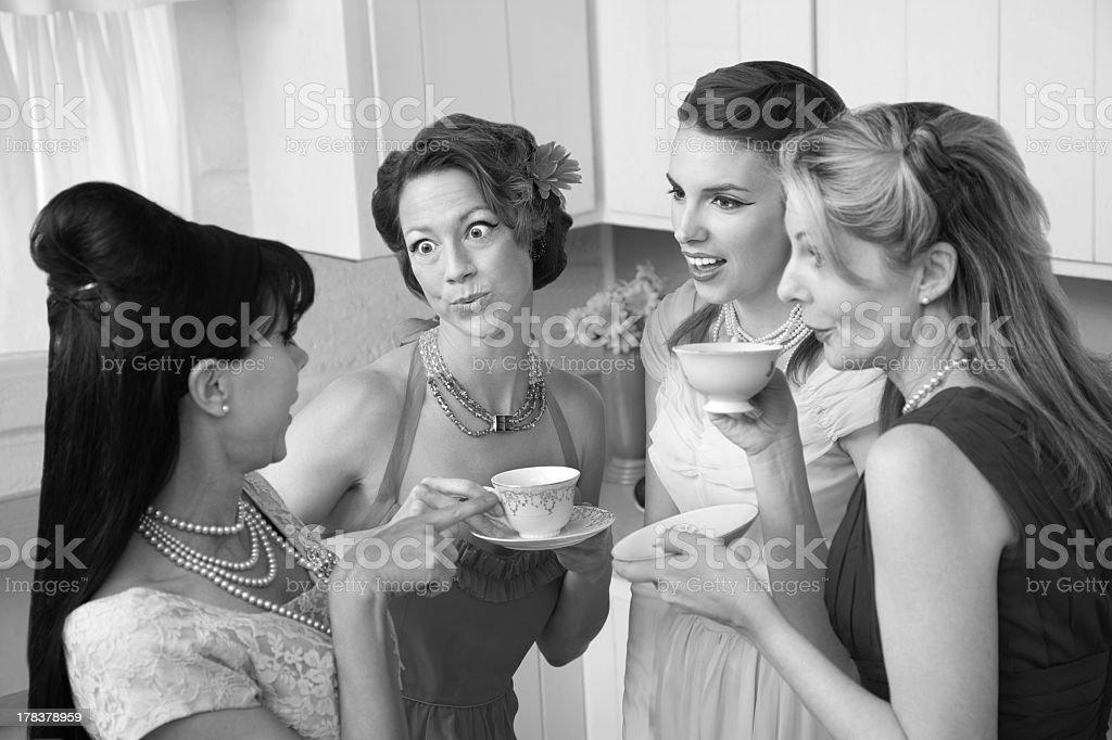 Four women drinking tea in black and white royalty-free stock photo