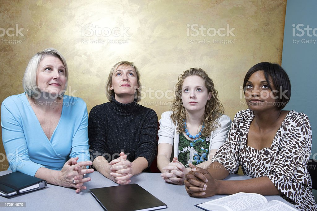 Four Women Look Up To The Heavens In Prayer royalty-free stock photo