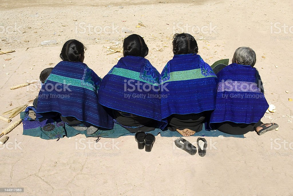 Four women sit on the ground in Zinacantan Chiapas Mexico royalty-free stock photo