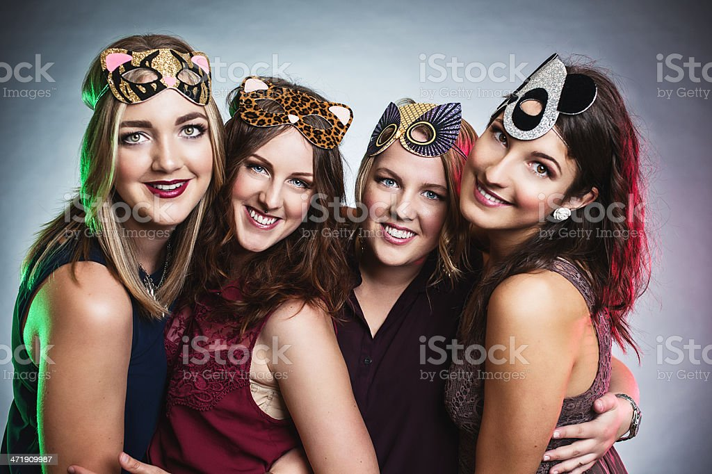 Four women with animal masks at a maskerade stock photo