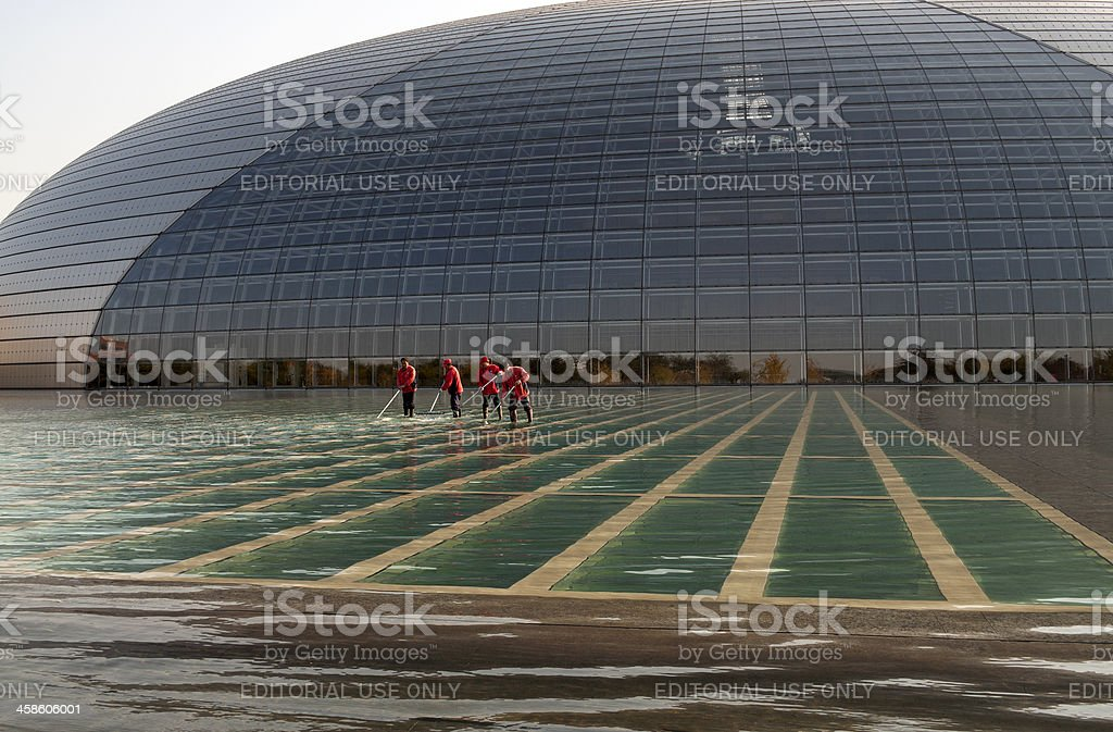 Four Workers in front of Beijing Opera House royalty-free stock photo