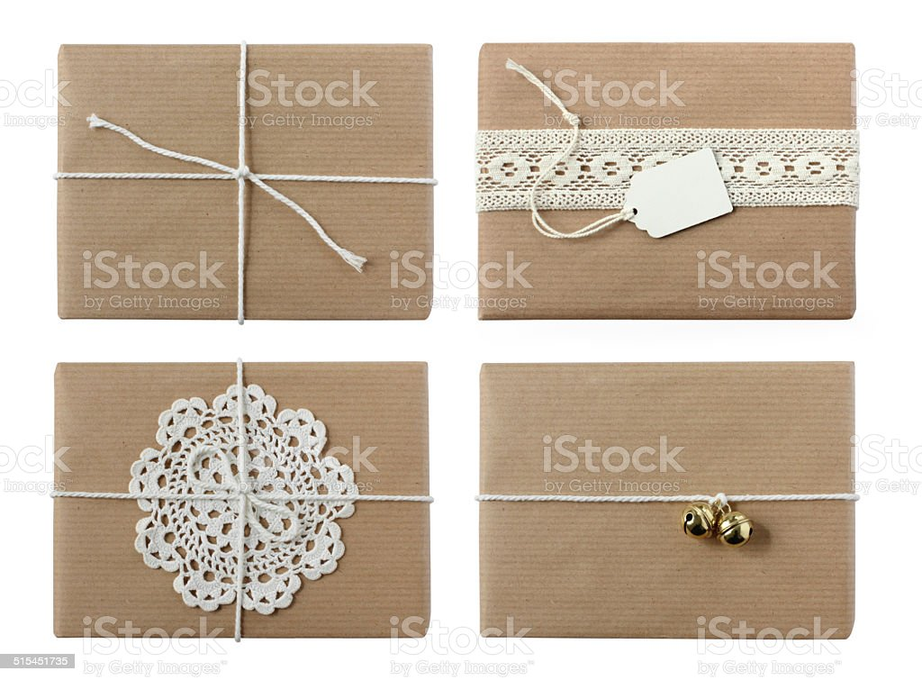 Four wrapped christmas / birthday gifts - isolated on white stock photo