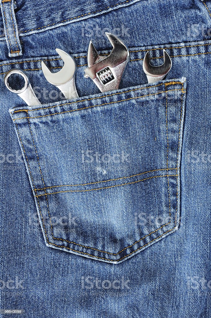 Four Wrenches in Blue Jean Pocket royalty-free stock photo