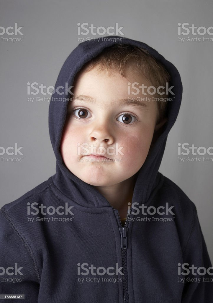 Four year old boy hoodie curious look royalty-free stock photo