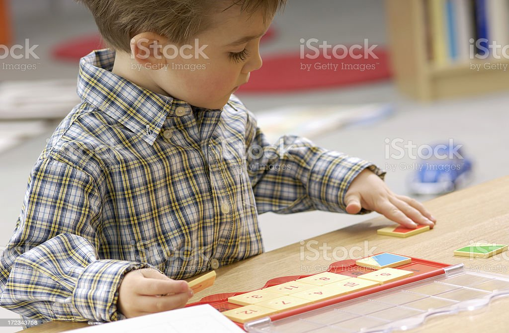 Four year old boy playing a learning game royalty-free stock photo