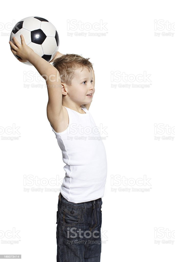 Four year old boy throwing a football royalty-free stock photo