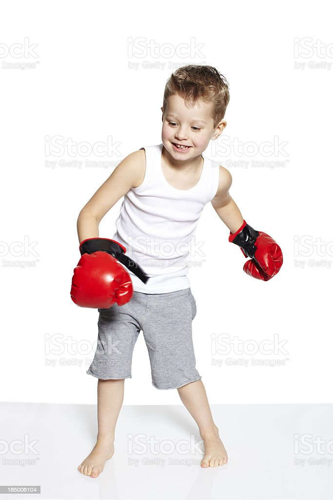 Four year old boy with boxing gloves stock photo