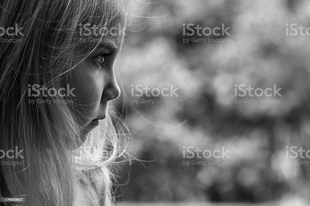 Four year old girl looking frustrated stock photo