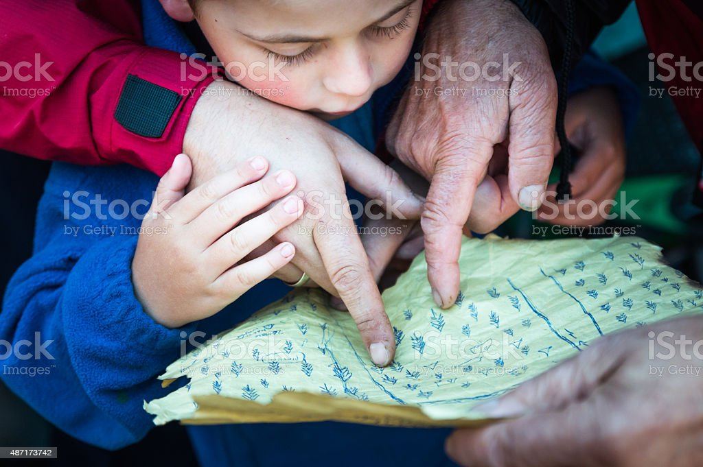 Four Years Old Boy With A Treasure Map stock photo