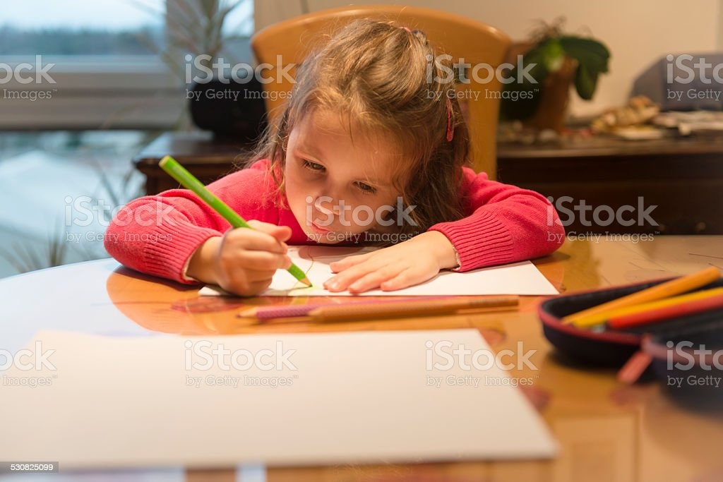 Four Years Old Girl in Pink Drawing, Balcony, Home, Evening stock photo