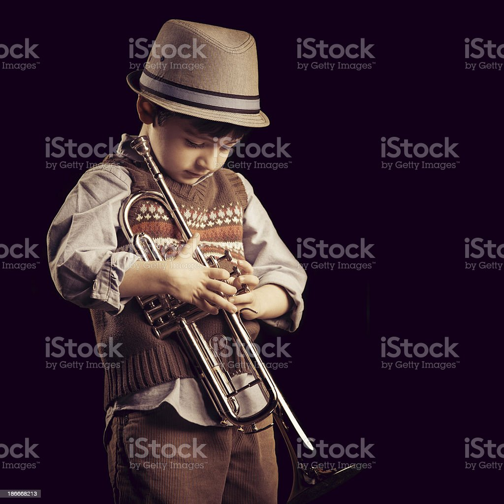 four years old kid with a trumpet stock photo
