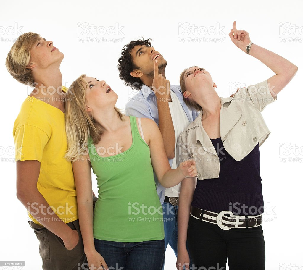 Four young adults looking and point up royalty-free stock photo