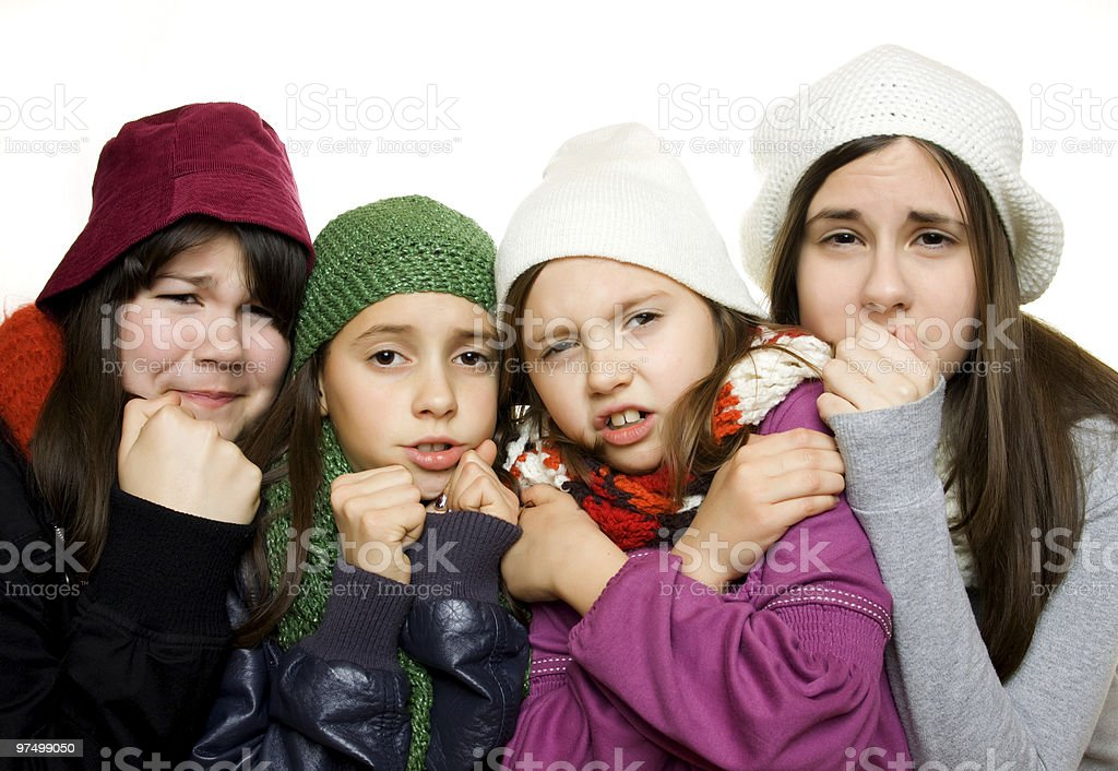 Four young girls in winter outfit stock photo