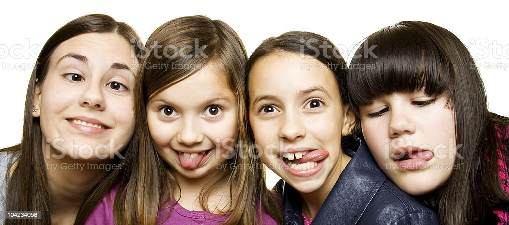 Four young girls making funny faces royalty-free stock photo