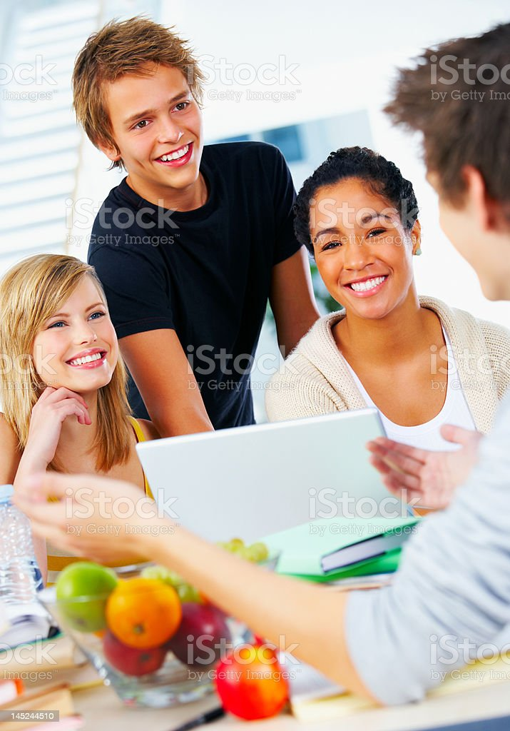 Four young students Smiling royalty-free stock photo