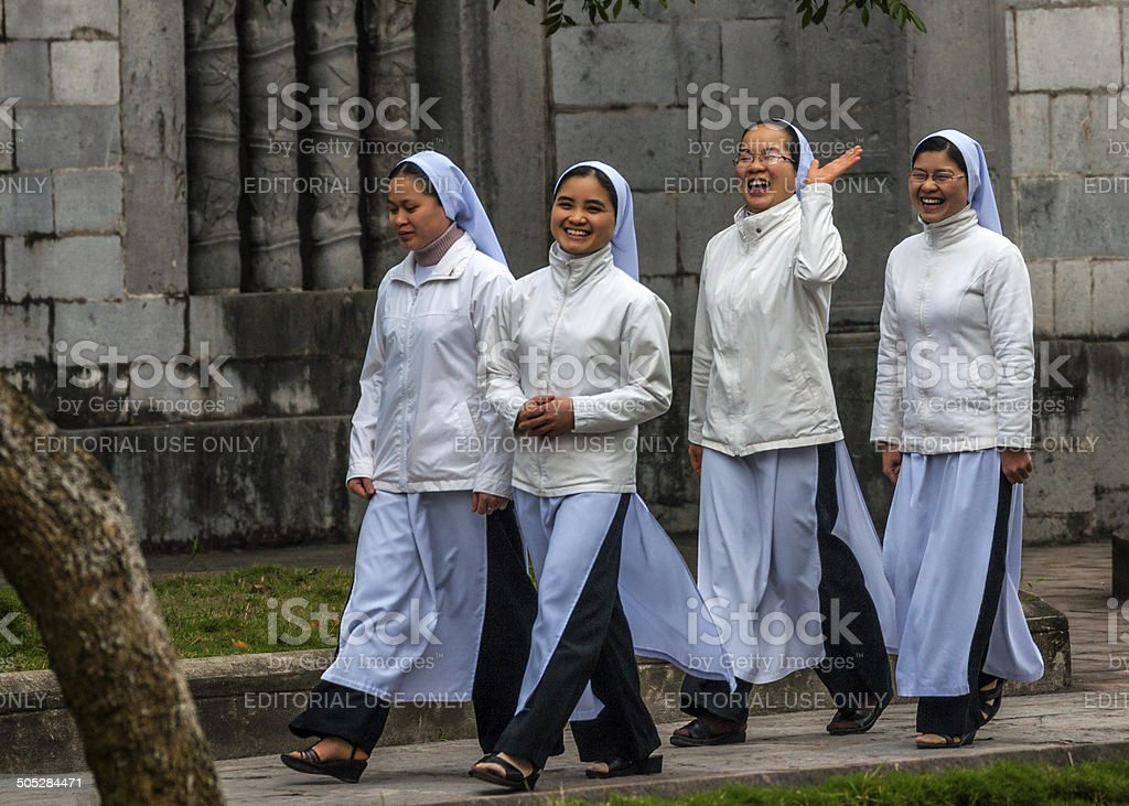 Four young Vietnamese nuns in Ao Dai. stock photo