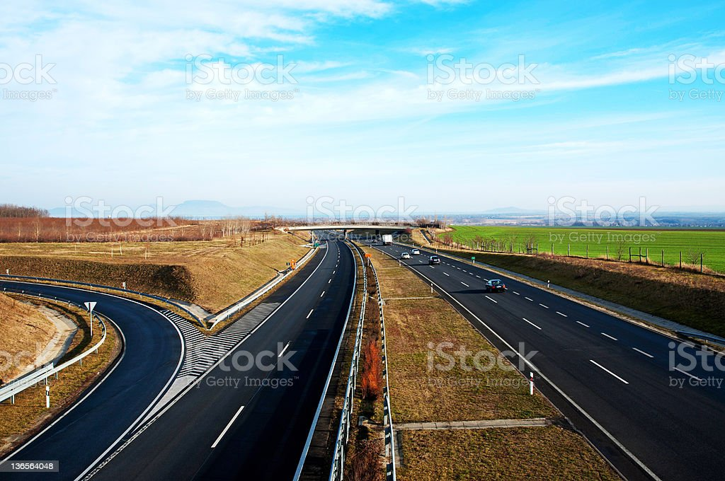 Four-lane motorway leads across the country royalty-free stock photo