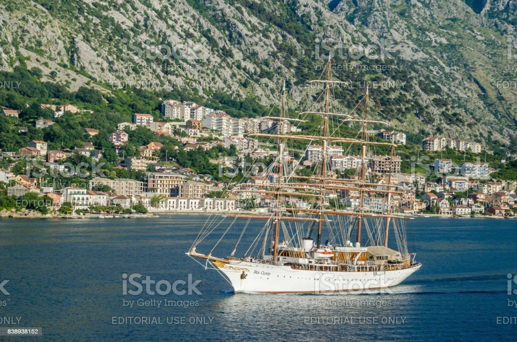 A four-masted  sailing vessel Sea Cloud moving into the port of Kotor stock photo