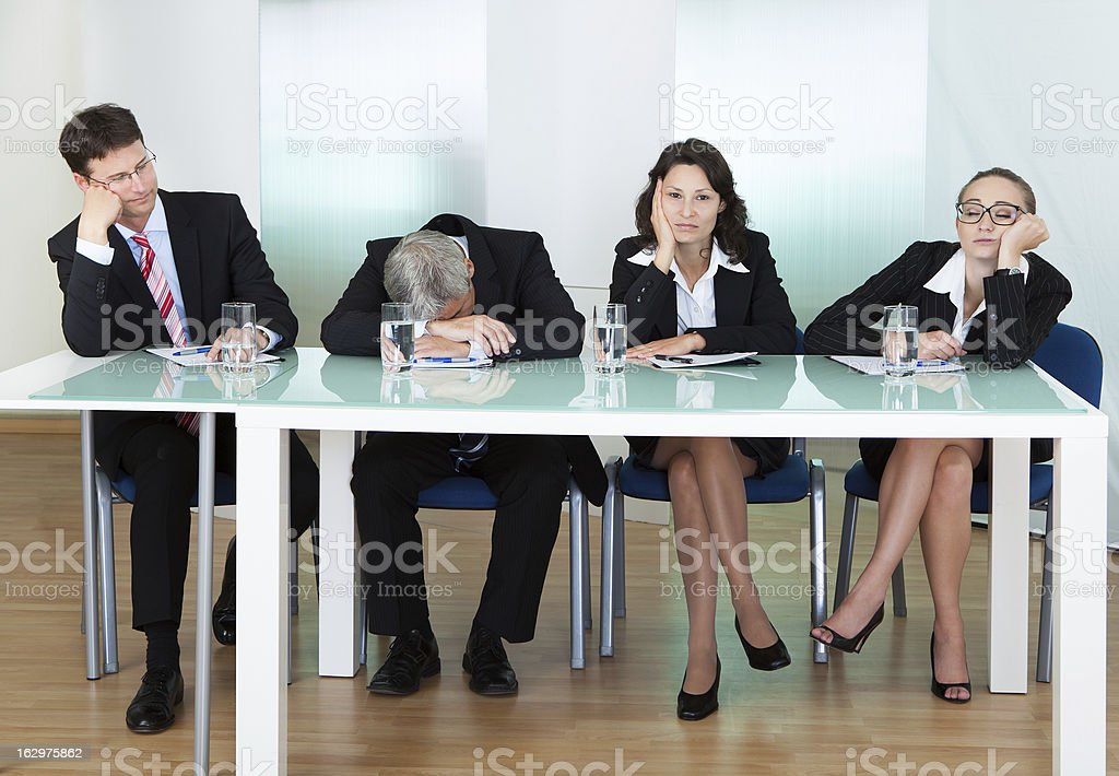 Four-member panel of judges in non-interested pose royalty-free stock photo