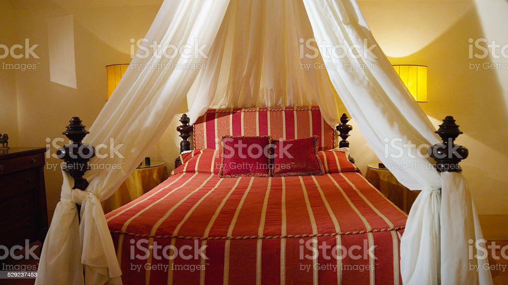 Four-poster Classic Luxurious Bed in Florence, Italy stock photo