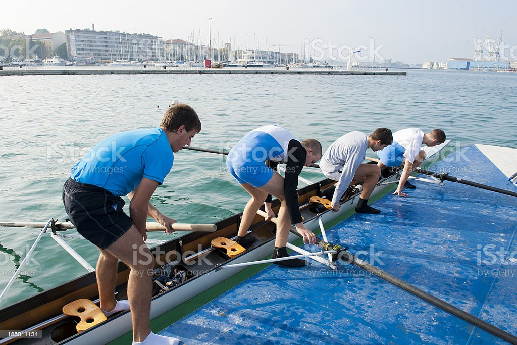 Four-seated scull rowing team embarking stock photo