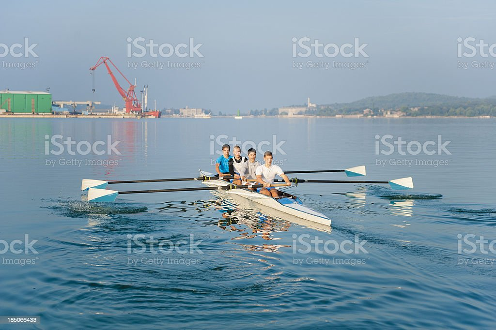Four-seated scull rowing team stock photo