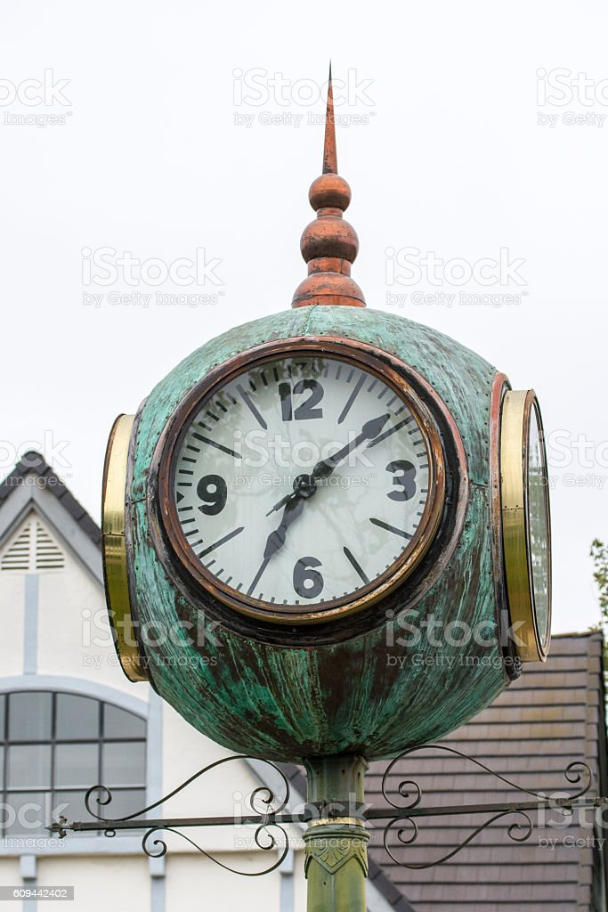 Four-sided cast iron street clock in Solvang, California. stock photo