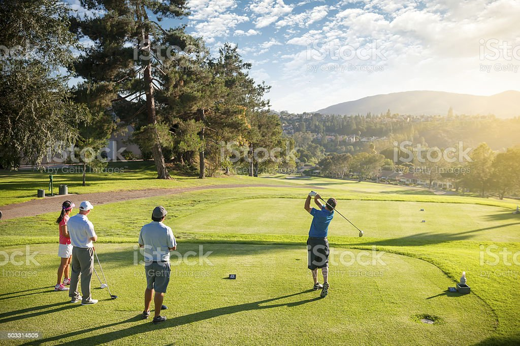 Foursome of Golfers stock photo