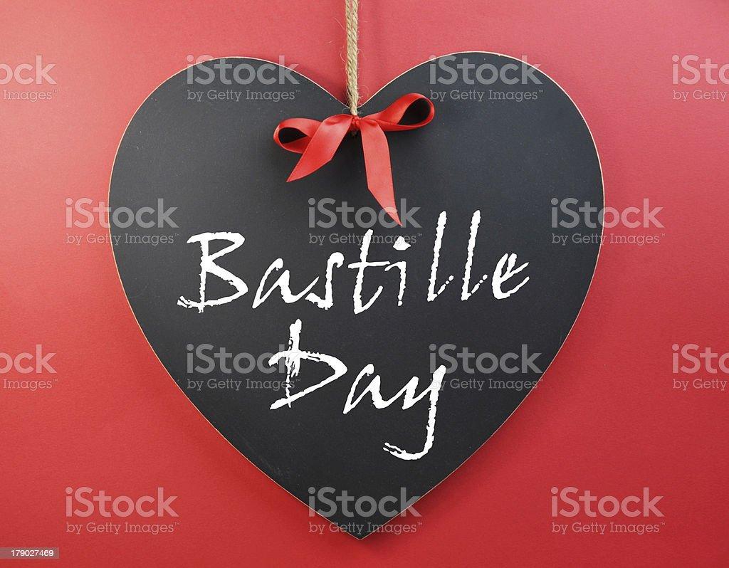 Fourteenth of July, Bastille Day, greeting on a heart-shape blackboard stock photo