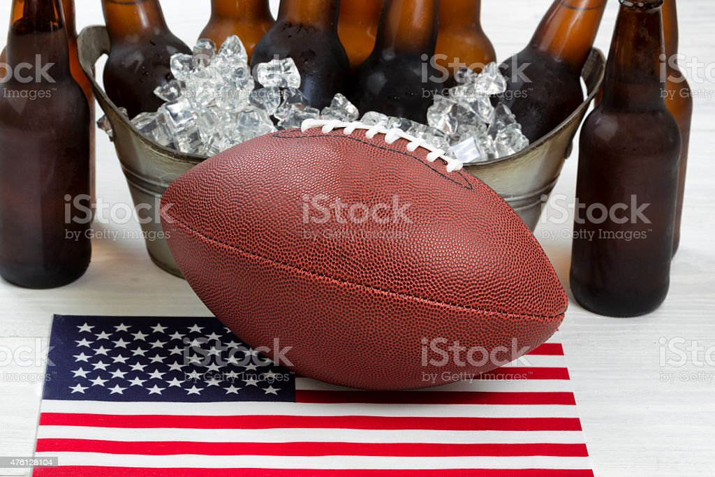 Fourth of July celebration with football and ice cold beer stock photo