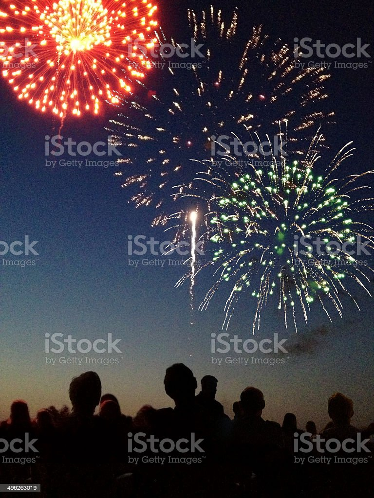 Fourth of July Firework Display with Spectators Vertical stock photo
