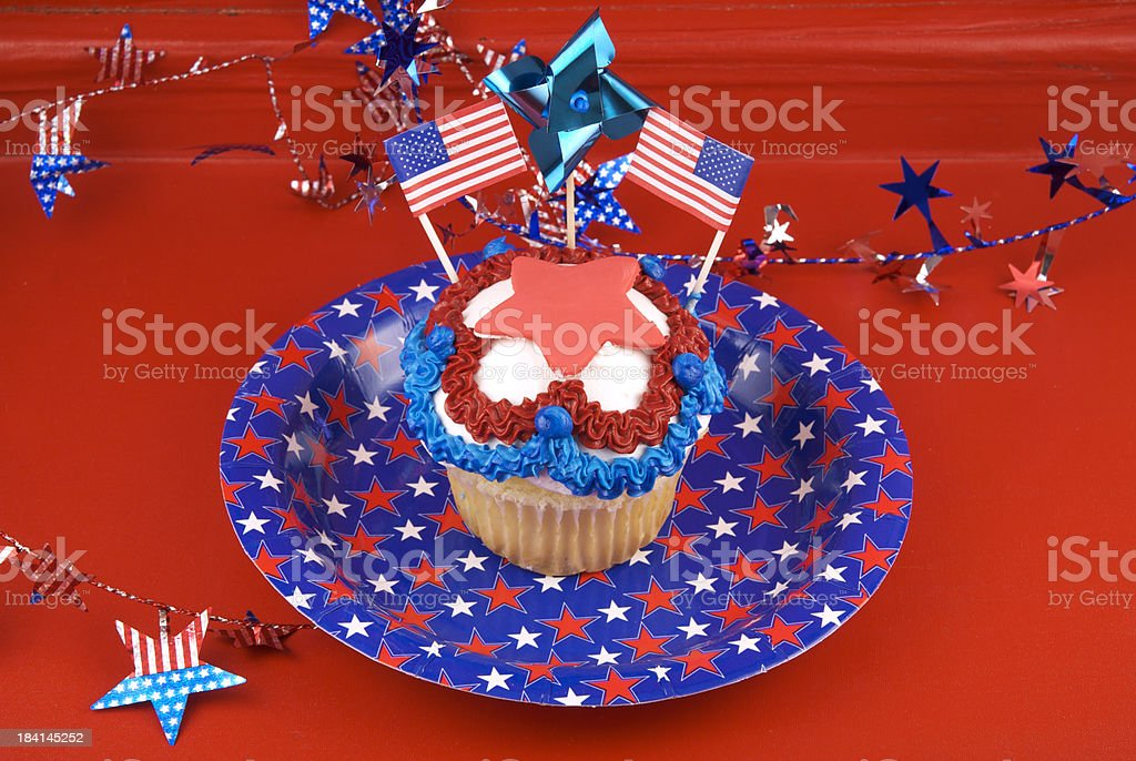 Fourth of July Picnic Cake, Patriotic Cupcake with American Flag stock photo