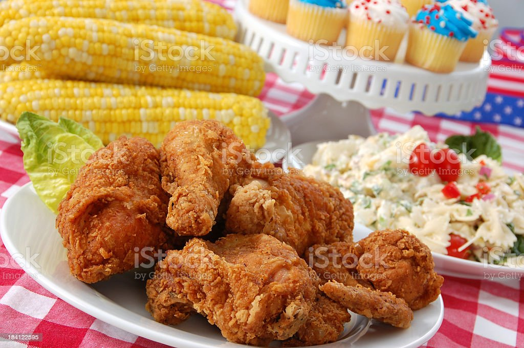 Fourth of July Picnic with chicken, corn and cupcakes stock photo