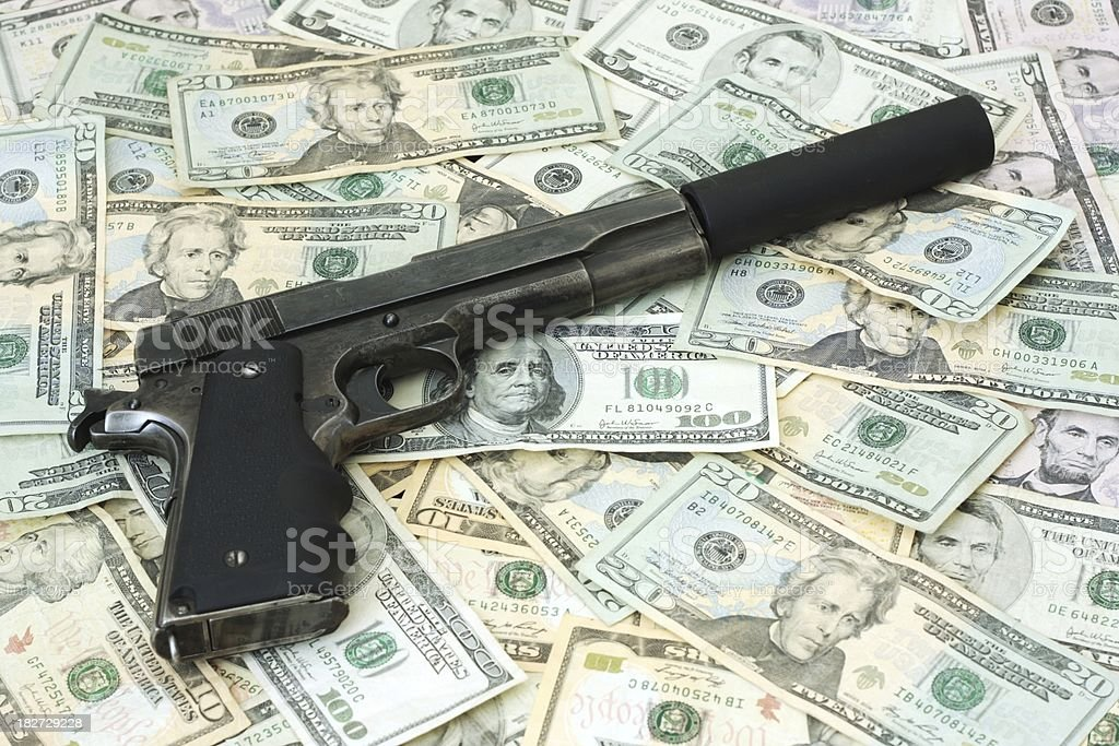 Fourty Five with a Silencer on Cash stock photo
