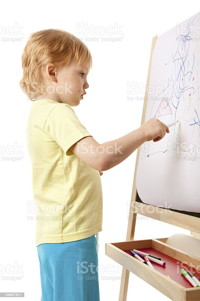 Four-year old boy drawing picture on easel royalty-free stock photo