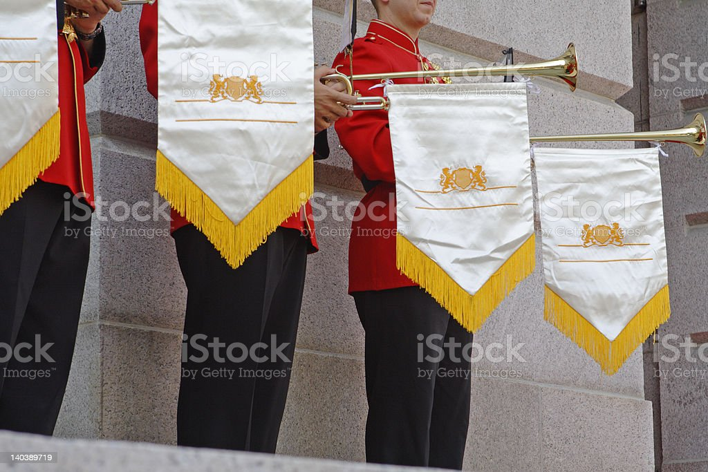 Fow of uniformed men with horns and penants royalty-free stock photo