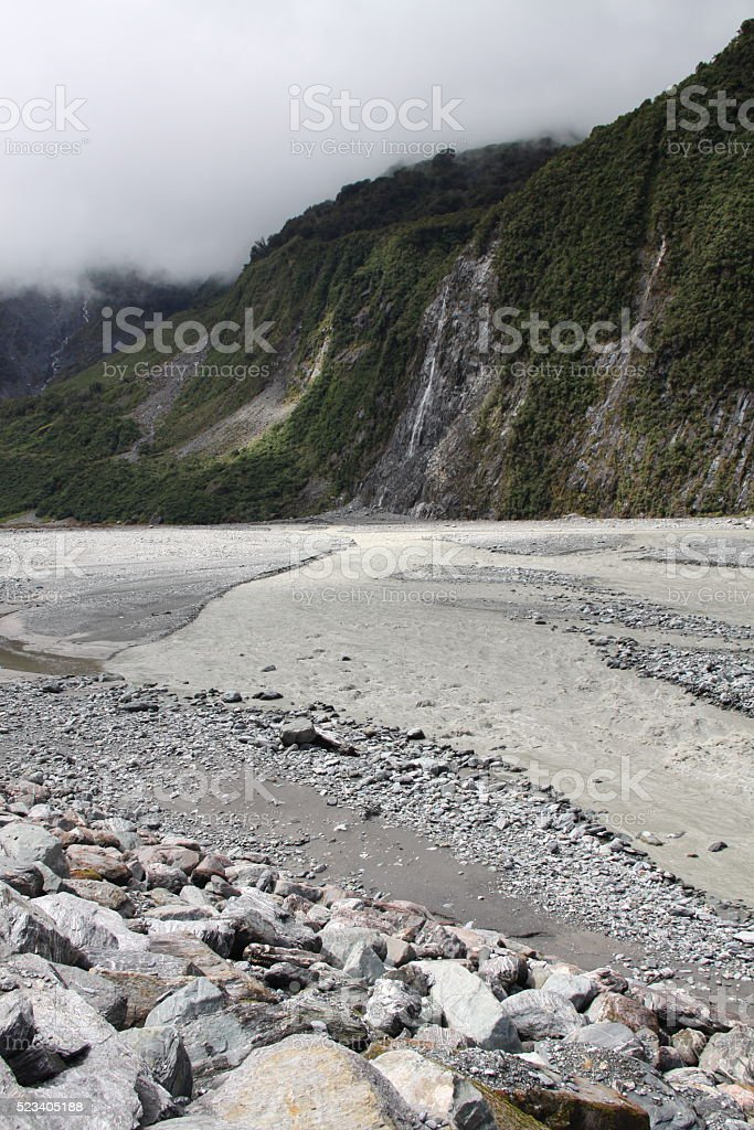 Fox Glacier in New Zealand with river and mountains stock photo