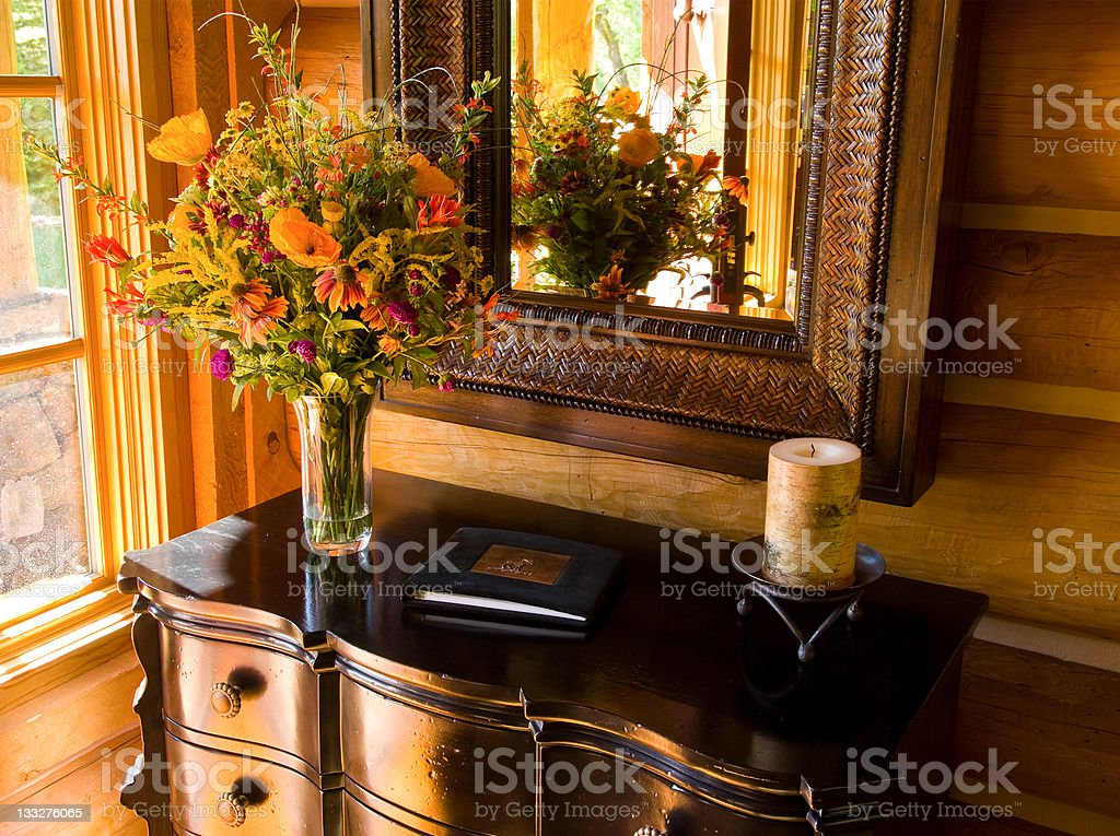 Foyer Table at Home Entrance with Flowers and Guest Book stock photo