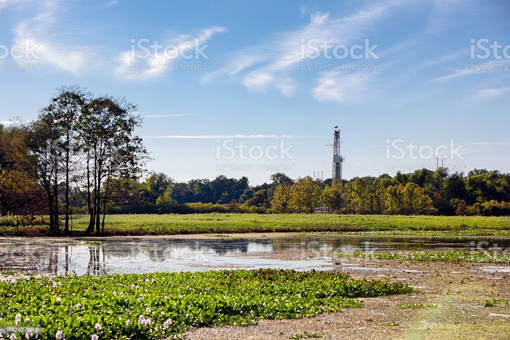 Fracking Drilling Rig Near a Louisiana Bayou stock photo