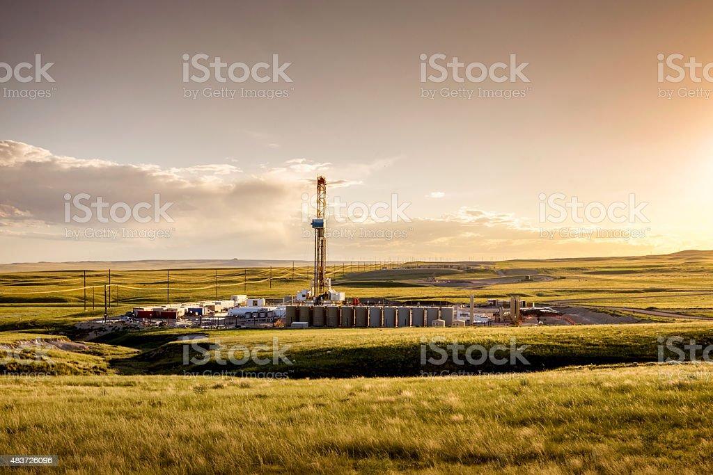 Fracking Fracking Drill Rig on the Prairie at Dusk stock photo