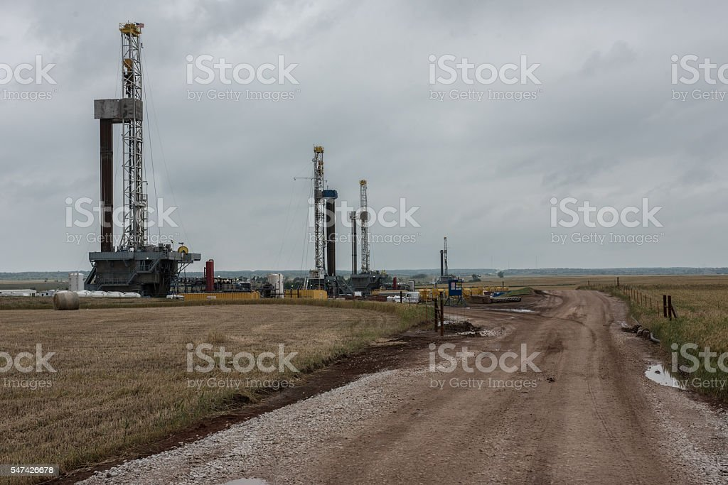 Fracking oil rig drills in Oklahoma field. stock photo