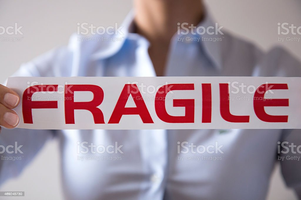 Fragile Businesswoman stock photo