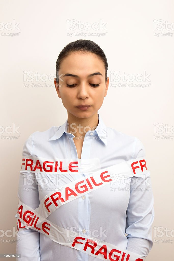 Fragile Businesswoman stock photo