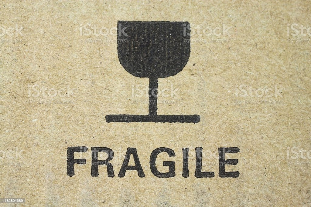 Fragile sign on cardboard stock photo